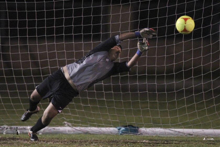 "Valhalla junior goalkeeper Febronio ""Dimas"" Orozco blocks the penalty kick that allowed the Norsemen to defeat Hilltop in the first round of the San Diego Section Division II playoffs. Valhalla prevailed 3-2 on PKs after a 1-1 tie in regulation."