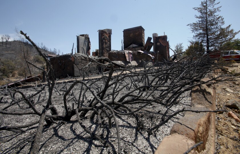 More than 100 dwellings, including this one the Peeples Valley area, were destroyed in the Yarnell Hill fire in Arizona last summer. The wildfire killed 19 members of the Granite Mountain Interagency Hotshot Crew.