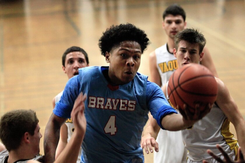 El Cajon Valley senior guard Syon Hicks, who had a game-high 26 points, drives to the basket.