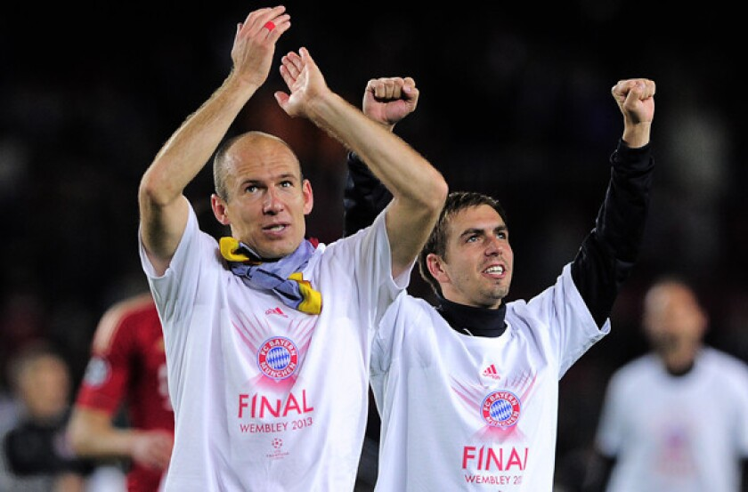 Bayern Munich midfielder Arjen Robben, left, and defender Philipp Lahm celebrate after defeating FC Barcelona, 3-0, on Wednesday in the UEFA Champions League semifinal.