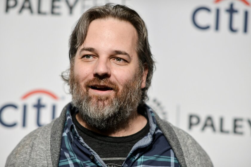 "FILE - In March 26, 2014 file photo, Dan Harmon arrives at PALEYFEST 2014 - ""Community"" in Los Angeles. The axed NBC sitcom ""Community"" will make its Yahoo debut in March. Yahoo announced Tuesday, Jan. 13, 2015, that sitcom will begin its online life with a pair of episodes.  (Photo by Richard Shot"