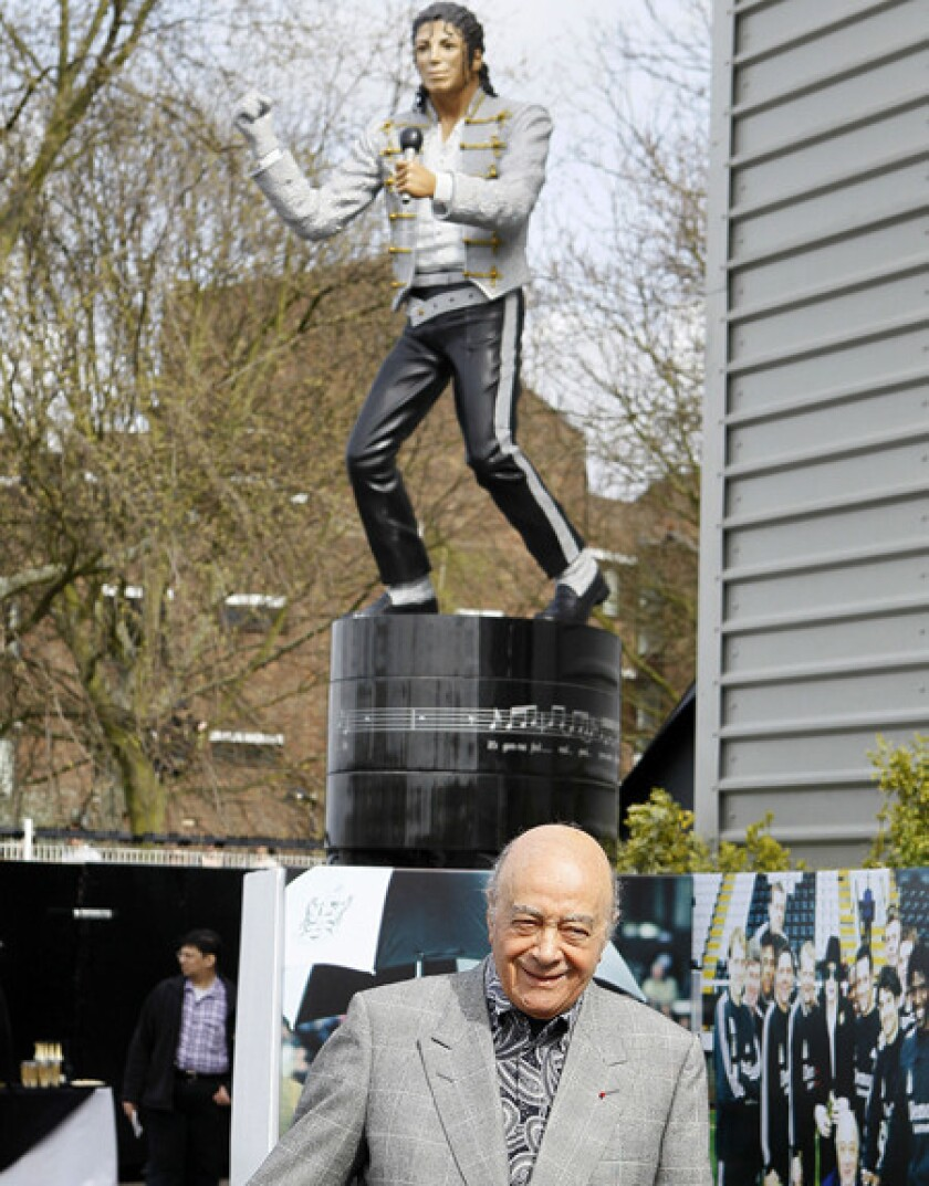 Fulham owner Mohamed Al Fayed is all smiles after unveiling a statue of Michael Jackson at the Craven Cottage Stadium grounds in London.