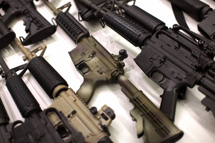 A collection of AR-15-style guns.