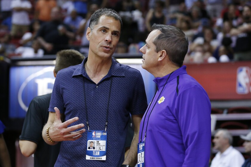 Rob Pelinka, left, chats with Lakers coach Frank Vogel during a Summer League game in Las Vegas.