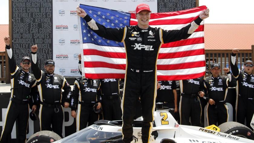 Josef Newgarden celebrates in victory lane after winning an IndyCar race at Mid-Ohio Sports Car Course in Lexington, Ohio, Sunday, July 4, 2021. (AP Photo/Tom E. Puskar)