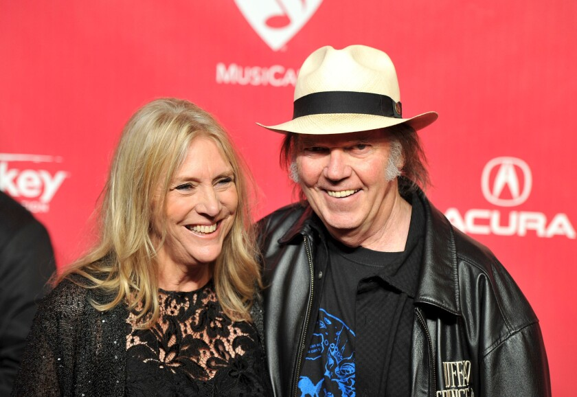 Pegi Young and Neil Young, shown in 2012, are divorcing after nearly 37 years of marriage.
