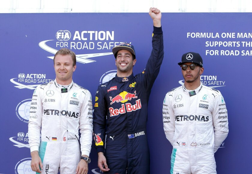 Red Bull driver Daniel Ricciardo of Australia, center, reacts after winning the qualification, at the Monaco racetrack, in Monaco, Saturday, May 28 2016. Mercedes driver Nico Rosberg of Germany, left, is second and Mercedes driver Lewis Hamilton of Britain, is third. The Formula one race will be he