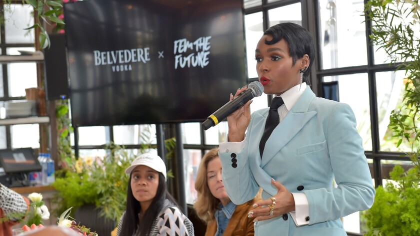 Janelle Monáe speaks to an audience of leading Hollywood players and stars at her Fem the Future organization's brunch at Catch LA in West Hollywood on Friday.