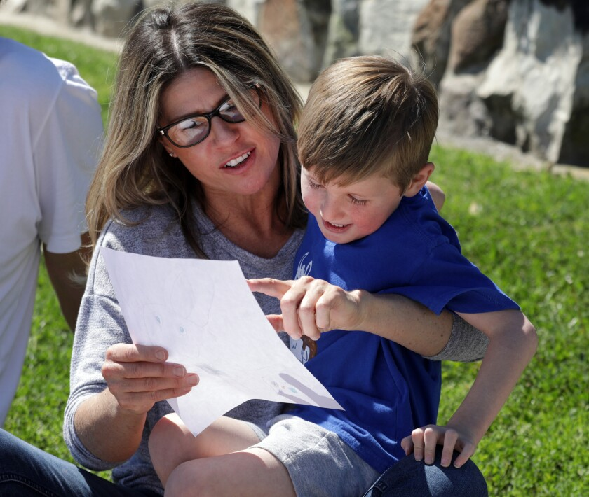 Lisa Hildreth is juggling working with homeschooling her four children, including her son, Eli Trafas.