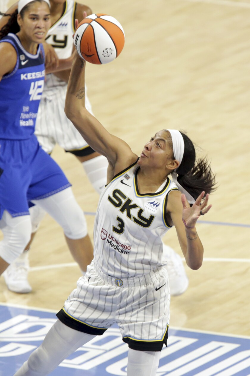 Chicago Sky's Candace Parker (3) tries to score during a WNBA basketball game against the Connecticut Sun, Saturday, June 19, 2021, in Chicago. (AP Photo/Eileen T. Meslar)
