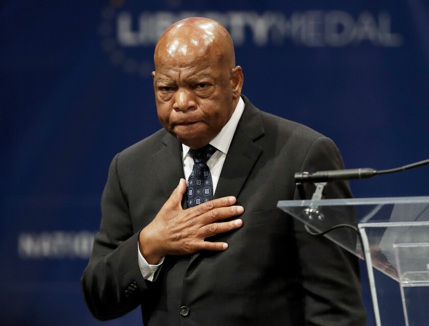 "U.S. Rep. John Lewis being presented with the Liberty Medal in September for his dedication to civil rights. At Wednesday's National Book Awards, Lewis was a winner of the young people's literature prize for his collaboration on the graphic novel ""March: Book Three."""