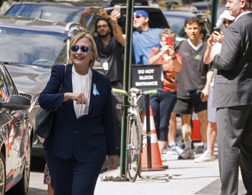 """Democratic presidential candidate Hillary Clinton walks from from her daughter's apartment building Sunday, Sept. 11, 2016, in New York. Clinton unexpectedly left Sunday's 9/11 anniversary ceremony in New York after feeling """"overheated,"""" according to her campaign. (AP Photo/Craig Ruttle)"""