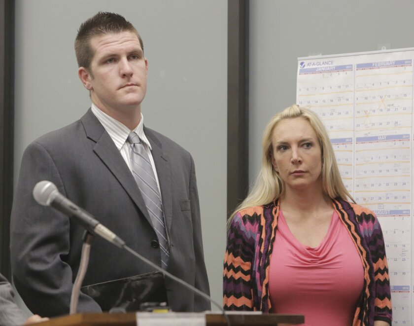 A long-running task force investigation led to husband and wife Bryce (left) and Jenneifer (right) Charpentier, San Diego police officers, who were arraigned on suspicion of drug sales, drug possession and drug transportation. They pleaded not guilty.