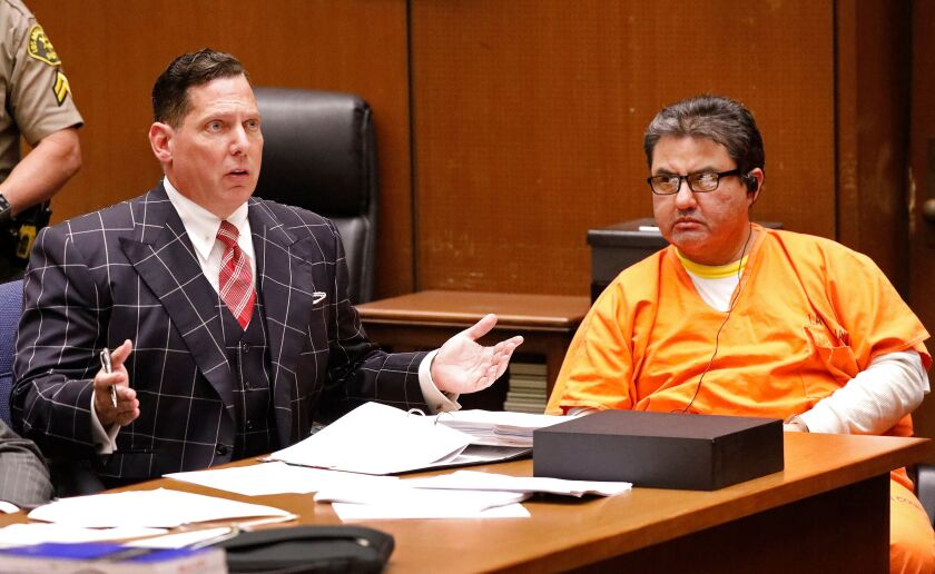 Naason Joaquin Garcia, right, leader of La Luz del Mundo church, and his defense attorney Ken Rosenfeld attend a bail review hearing at Los Angeles County Superior Court on July 15.