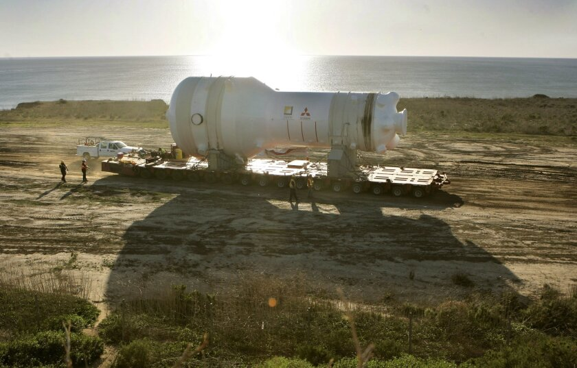 A large steam generator is slowly transported along the west side of Interstate 5, north of the Las Pulgas exit, on its way to the San Onofre Nuclear Generating Station.