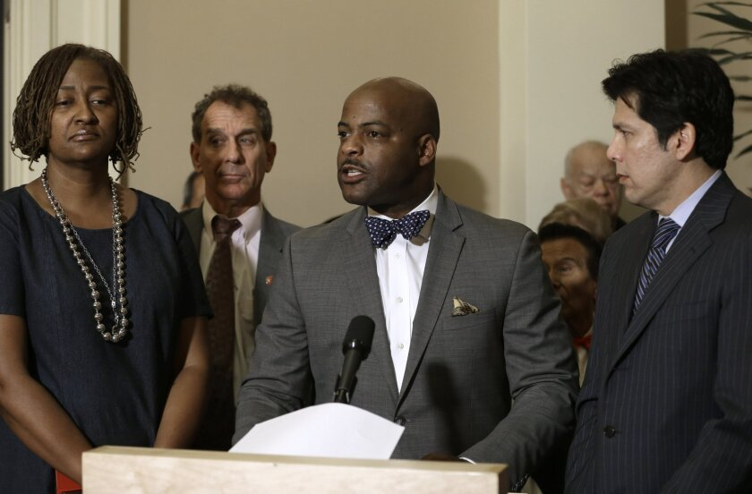 State Sen. Isadore Hall III, center, urged California to divest any business relationships with Donald Trump. Hall was accompanied by Sen. Holly Mitchell, left, Sen. Bob Wieckowski and Senate President Pro Tem Kevin de León.