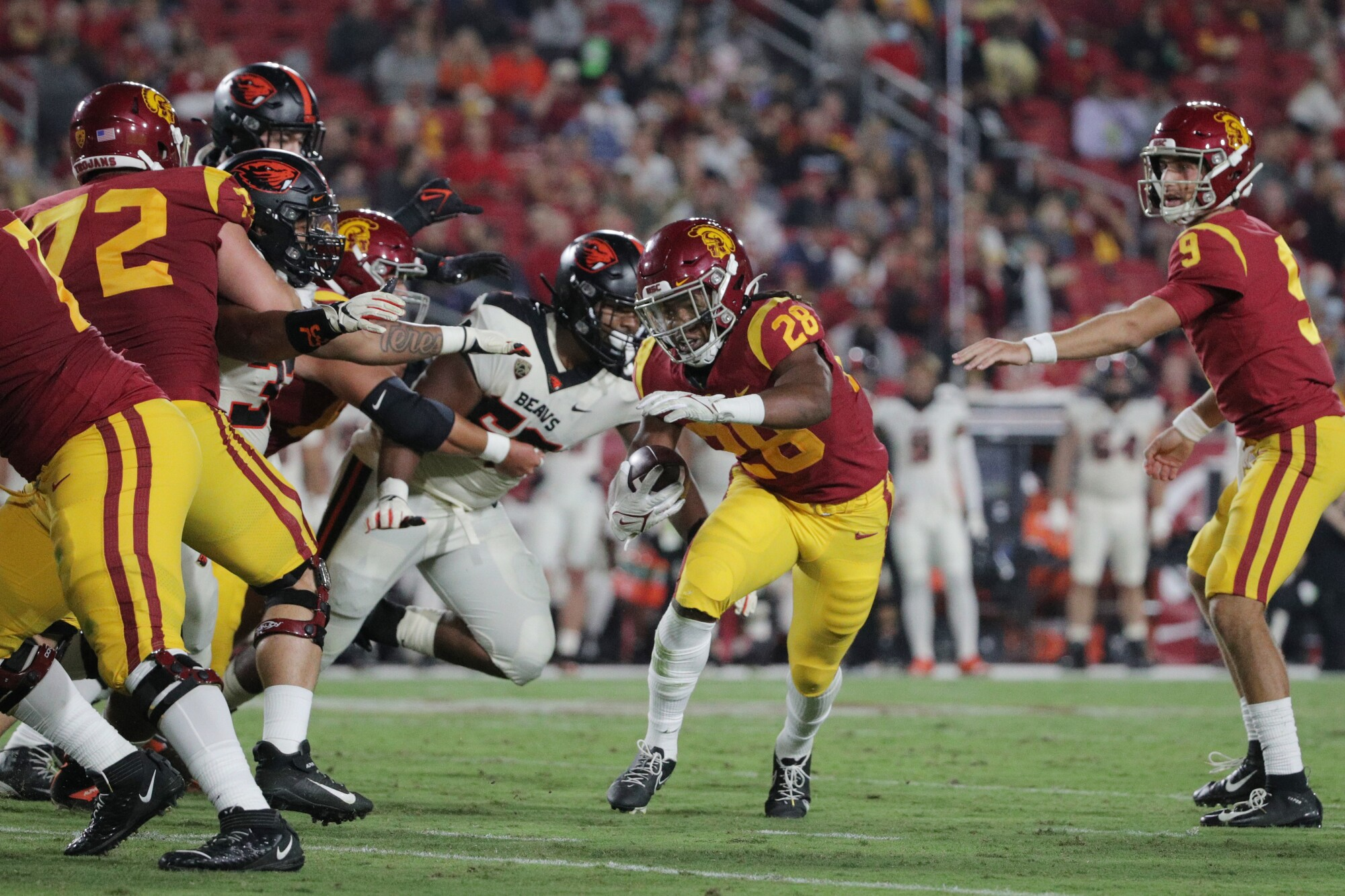 USC running back Keaontay Ingram eludes the Oregon State defense to score a first-half touchdown.