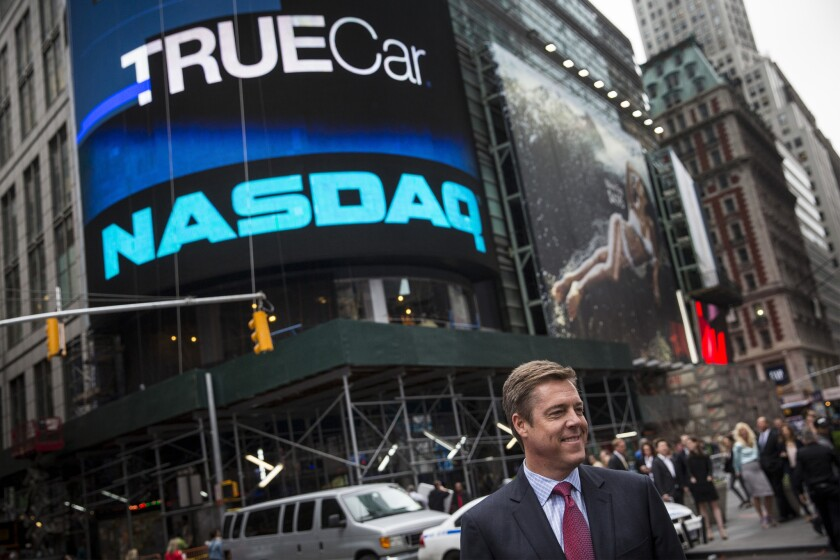 Scott Painter, CEO of TrueCar, stands outside the Nasdaq Exchange in Times Square in New York in this 2014 file photo. The company's shares plunged after it said it would miss its quarterly financial targets.
