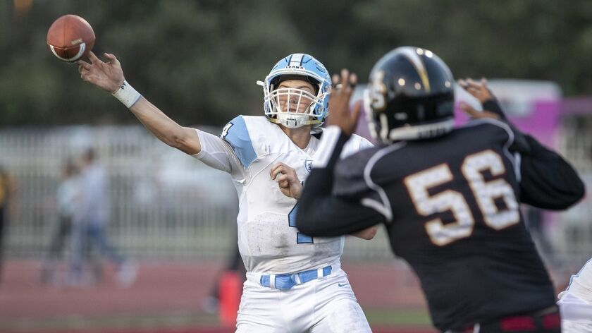 Corona del Mar's Ethan Garbers throws under pressure during a game against JSerra on Friday, August 17.