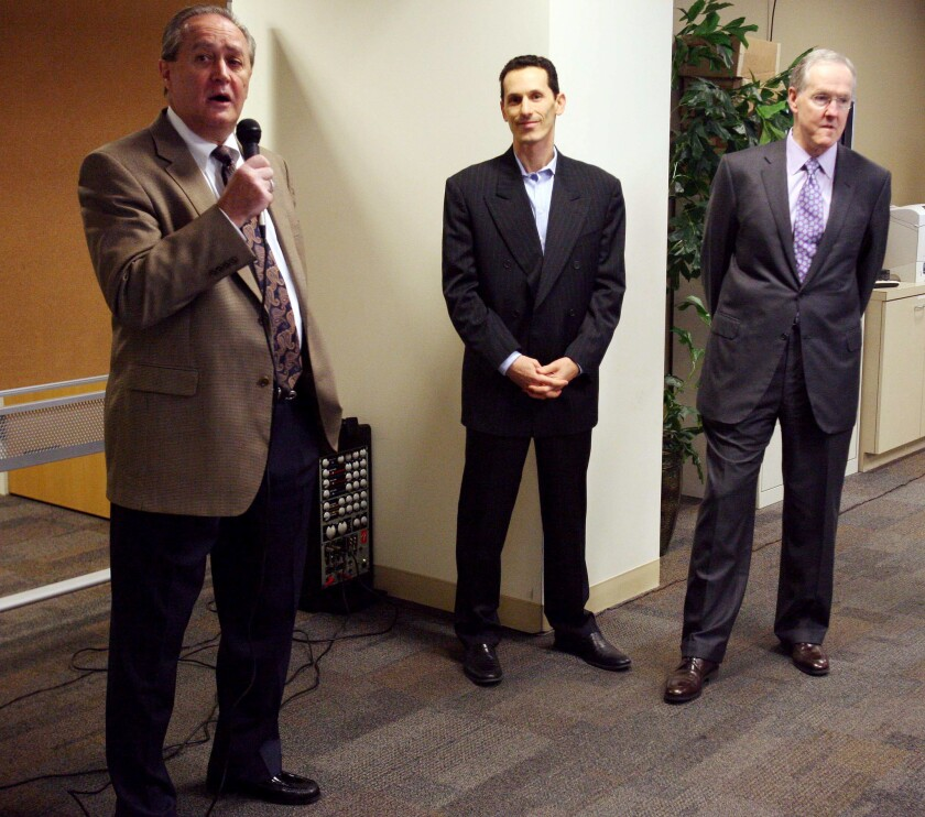 Riverside Press-Enterprise publisher Ron Redfern, left, Freedom Communications Chief Executive Aaron Kushner and Robert Decherd, former chairman of A.H. Belo, speak to Press-Enterprise employees about the proposed purchase of the paper for $27.25 million.