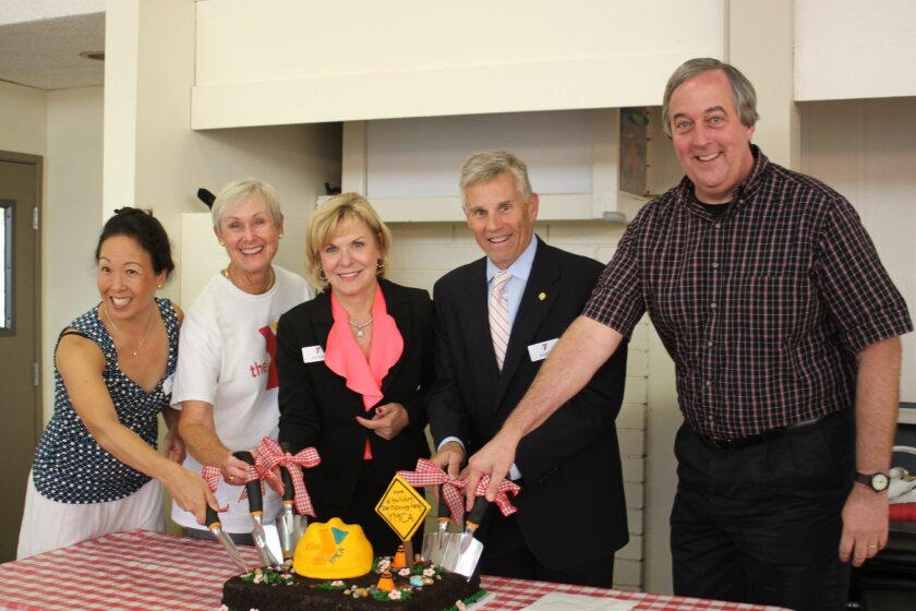 Annie So, Molly Schulze (McKinney), Sue Ball, Baron Herdelin-Doherty and Tim Golba 'break the ground' of the new facility — in cake form.
