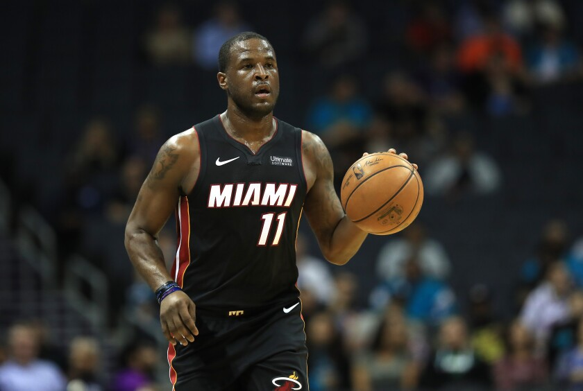 Miami's Dion Waiters brings the ball up court during a preseason game against the Hornets in Charlotte, N.C., on Oct. 9, 2019.