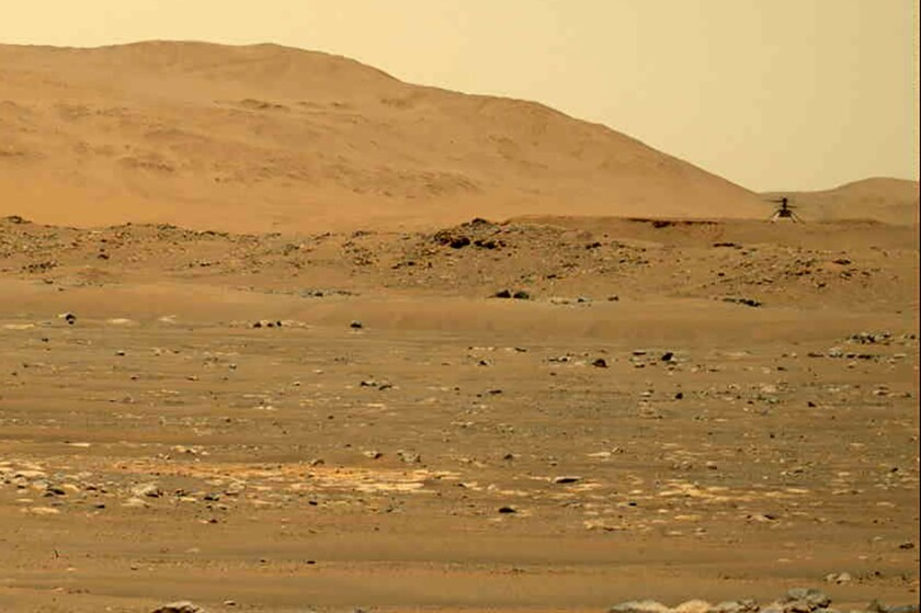 The Mars Ingenuity helicopter hovers.