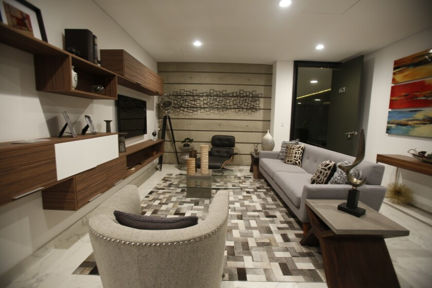 Cosmopolitan Residences will be a 42-unit tower in Colonia Cacho. Inside their showroom floor.