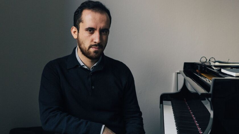 A photograph of pianist Igor Levit. Credit: Robbie Lawrence