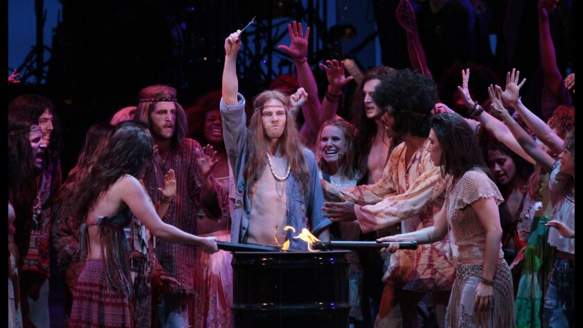 "Hunter Parrish (center, arm up) as Claude and the ensemble in the performance of ""Hair"" at the Hollywood Bowl on Aug. 1, 2014."