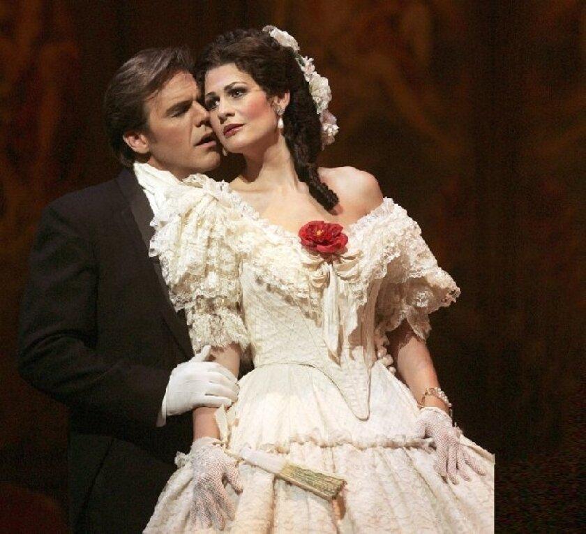 "Anja Harteros (with Richard Troxell) in the San Diego Opera's 2004 ""La Traviata."" San Diego Opera"