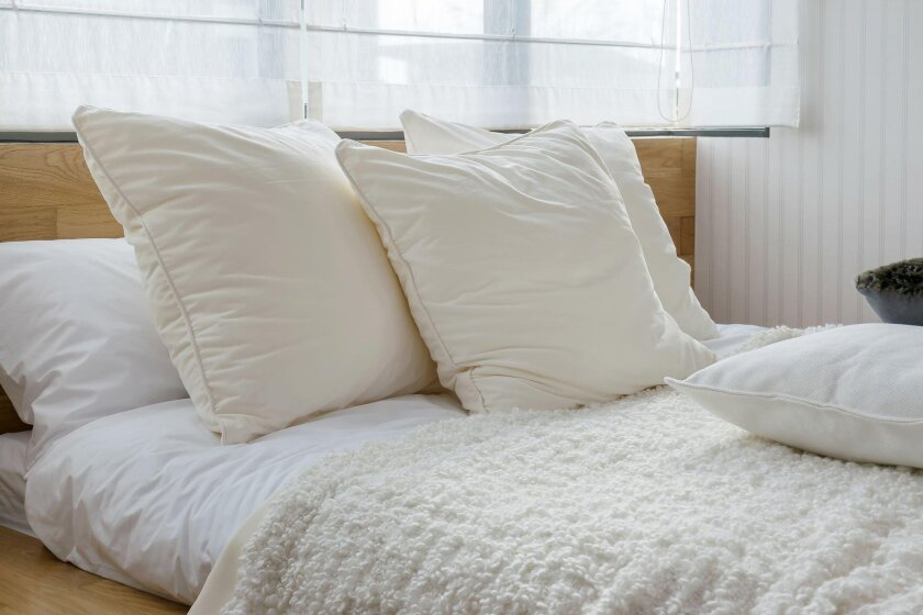 A less-than-perfectly-made bed is trendy right now.