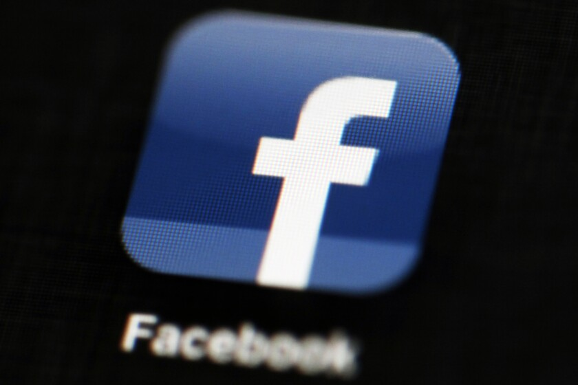 File photo shows the Facebook app logo on a mobile device