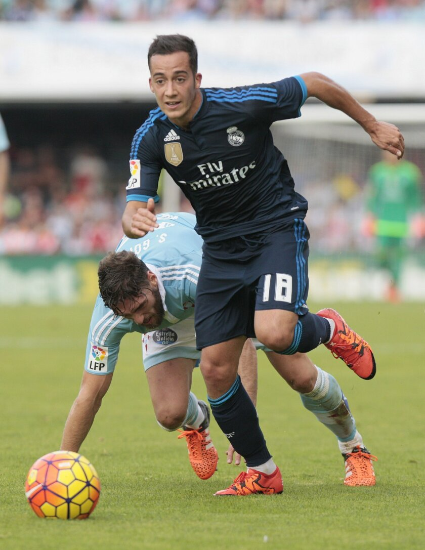 FILE - In this Saturday, Oct. 24, 2015 filer, RC Celta's Sergio Gómez, left, challenges for the ball with Real Madrid's Lucas Vazquez during a Spanish La Liga soccer match between RC Celta and Real Madrid, at the Balaídos stadium in Vigo, Spain. Many nations are betting on youth at the European Cha