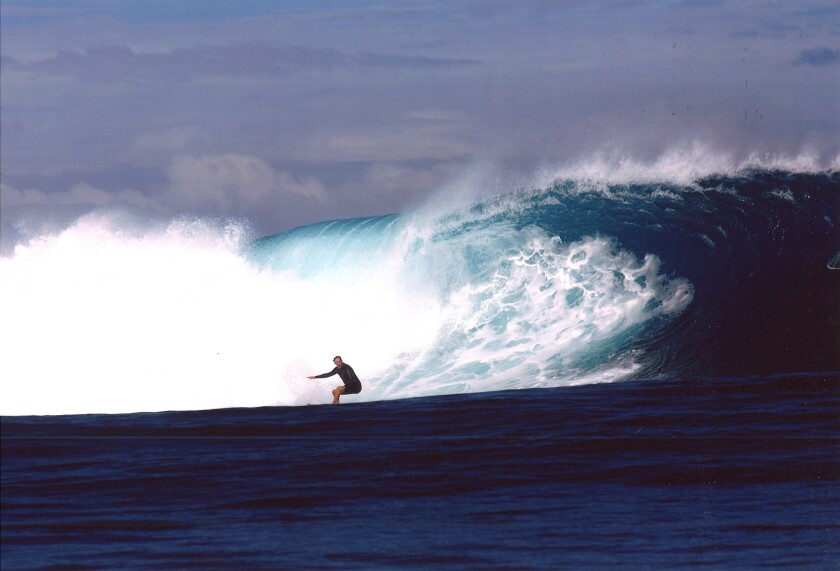 "William Finnegan surfing, Cloudbreak, Fiji, 2005. Image from the book ""Barbarian Days"" by William Finnegan."