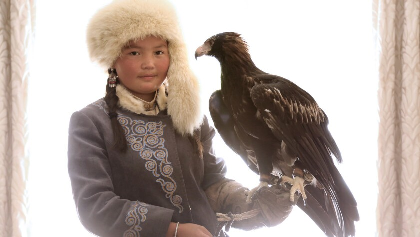 "Aisholpan, star of the documentary ""The Eagle Huntress, "" became the first female from her Kazakh family to become an eagle hunter."