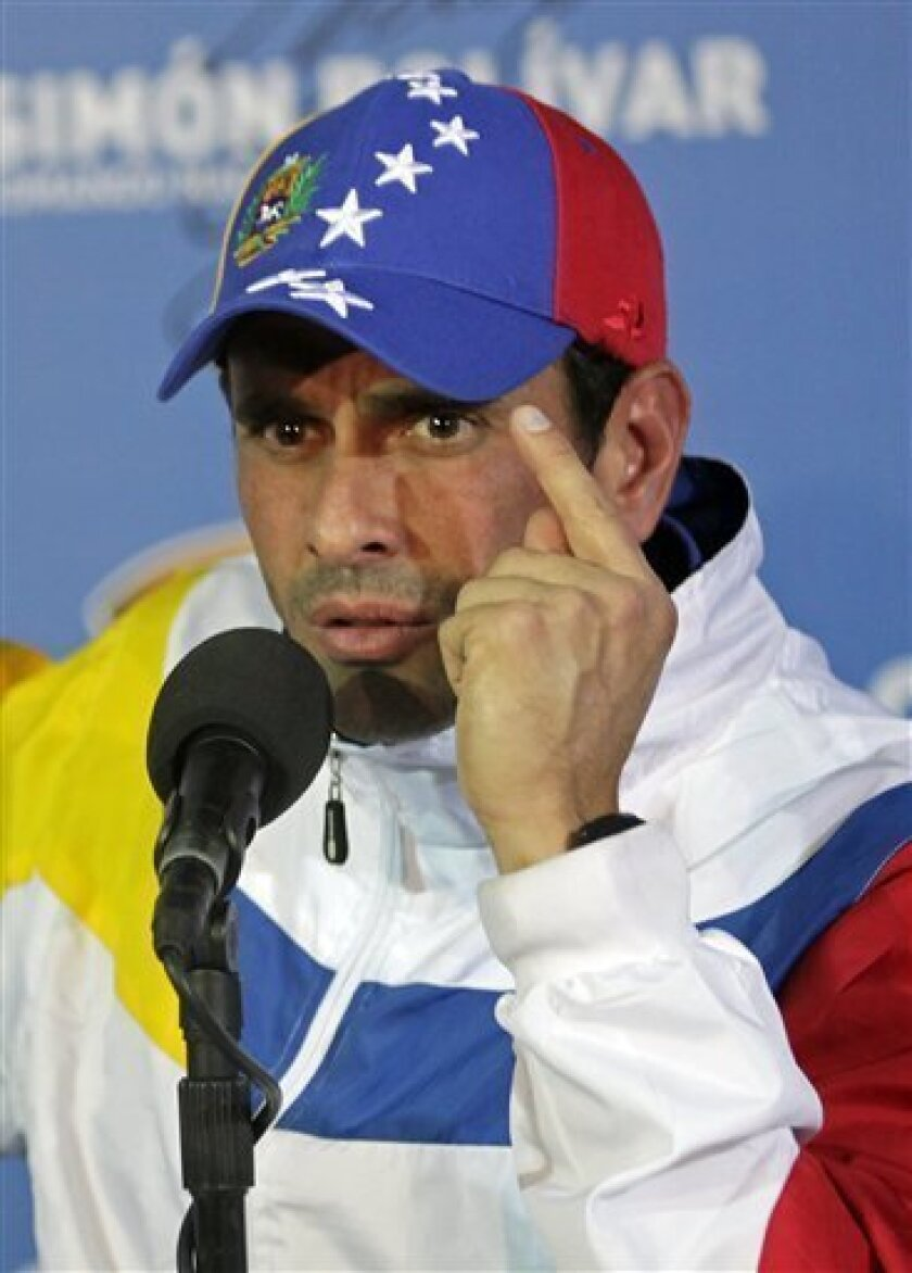 Opposition presidential candidate Henrique Capriles talks to journalists during a press conference at his campaign headquarters in Caracas, Venezuela, Tuesday, April 16, 2013. Capriles called off the planned opposition march in Caracas Wednesday demanding a vote-by-vote recount of Sunday's presidential election after President-elect Nicolas Maduro summoned his supporters to take to the streets in the capital, raising the possibility of a confrontation with anti-government protesters. (AP Photo/R