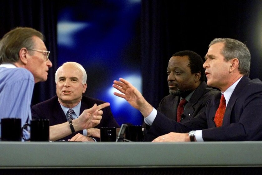 FILE - In this Feb. 15, 2000 file photo, Larry King, host of CNN's Larry King Live, asks a question to the Republican presidential candidates, from left, Sen. John McCain, Alan Keyes, and Gov. George W. Bush of Texas, during the Republican presidential debate in Columbia, S.C. King, who interviewed presidents, movie stars and ordinary Joes during a half-century in broadcasting, has died at age 87. Ora Media, the studio and network he co-founded, tweeted that King died Saturday, Jan. 23, 2021 morning at Cedars-Sinai Medical Center in Los Angeles. (AP Photo/Eric Draper, Pool)