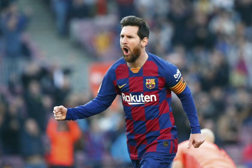 FC Barcelona's Lionel Messi celebrates after scoring his side's opening goal during a Spanish La Liga soccer match between Barcelona and Eibar on Feb. 22 in Barcelona, Spain.