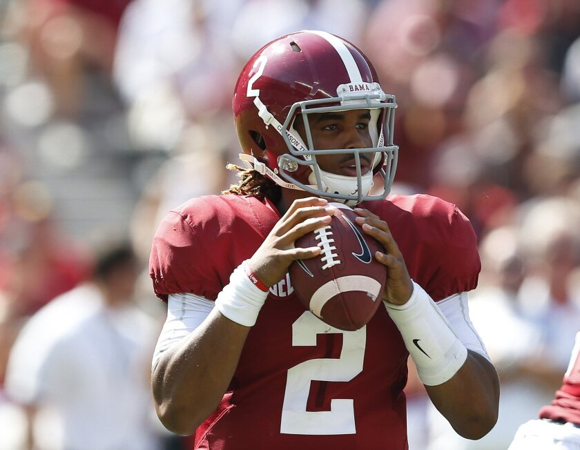 Alabama quarterback Jalen Hurts sets back to pass during the first half of an NCAA college football game against Western Kentucky, Saturday, Sept. 10, 2016, in Tuscaloosa, Ala. (AP Photo/Brynn Anderson)