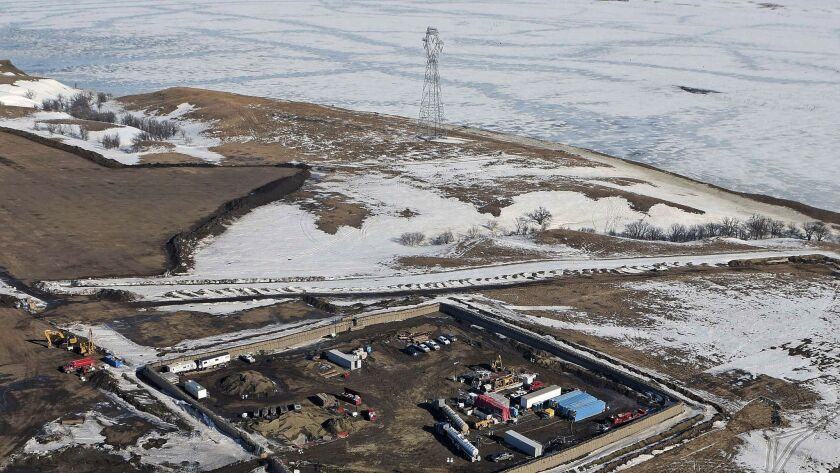 Boring equipment routing the Dakota Access Pipeline underground and across Lake Oahe to connect with the existing pipeline in Emmons County on Feb. 13, in Cannon Ball, N.D.