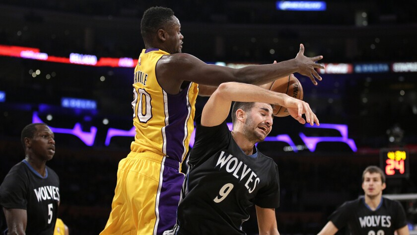 Lakers forward Julius Randle beats Timberwolves guard Ricky Rubio to a rebound in the second half Wednesday night.