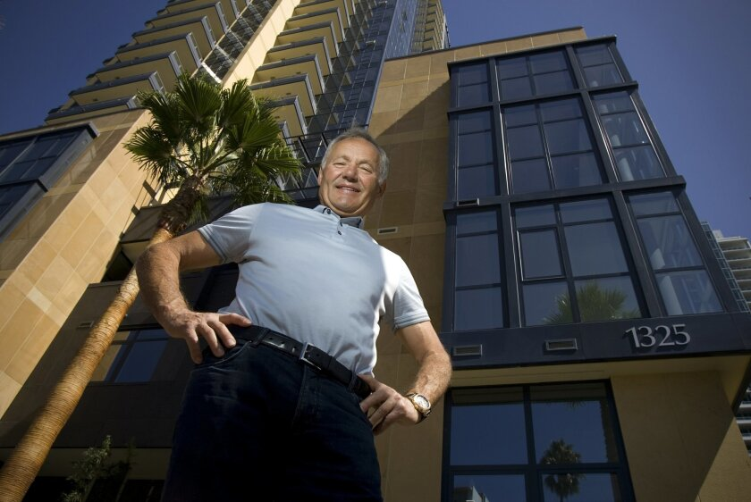 Nat Bosa stood next to his Bayside condominium tower. He says it is too hard for people to get home loans today. (Nelvin C. Cepeda / Union-Tribune)
