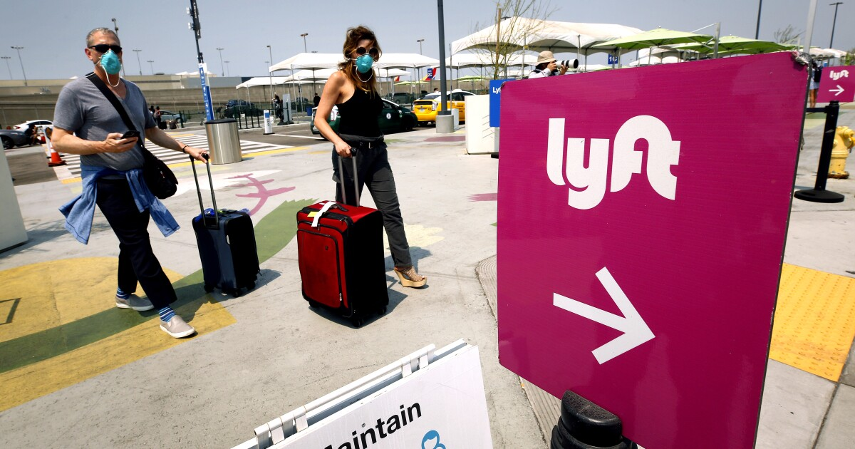 www.latimes.com: How Uber and Lyft persuaded California to vote their way