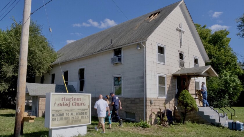 This Sunday, Sept. 19, 2021 photo shows the historic Harlem Baptist Church in Kansas City, Mo. A federal investigation is underway after arson damaged the church that now serves a congregation predominantly made up of people from the South Sudan. John Ham of the Kansas City office of the Bureau of Alcohol, Tobacco, Firearms and Explosives told the Kansas City Star that authorities have determined that the blaze was intentionally set, making it a federal crime. (Robert A. Cronkleton/The Kansas City Star via AP)