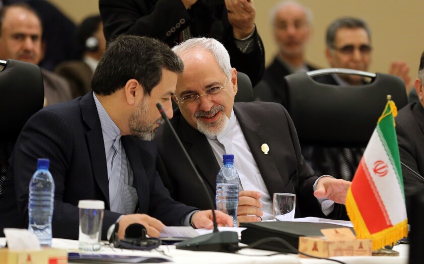 The Obama administration said comments by Iranian Deputy Foreign Minister Abbas Araqchi, left, pictured in November with Foreign Minister Mohammad Javad Zarif in Tehran, had been misconstrued and that there is no hidden plan.