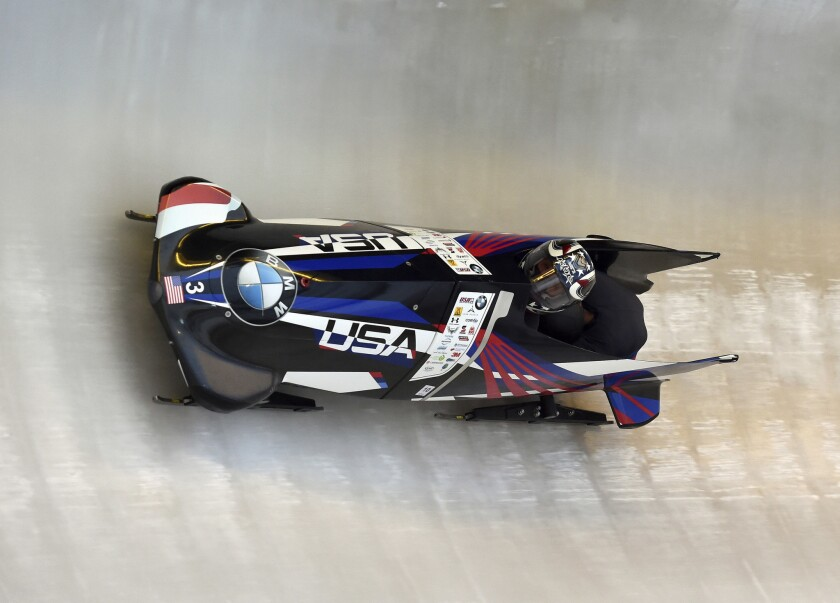Pilot Elana Meyers Taylor and Lauren Gibbs speed down the course during a World Cup competition in Winterberg, Germany, on Dec. 9.