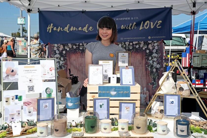 Chemisphere & Co. owner Connie Chiu, 37, of Newport Beach, sells handmade candles and essential oils at the O.C. Swap Meet.