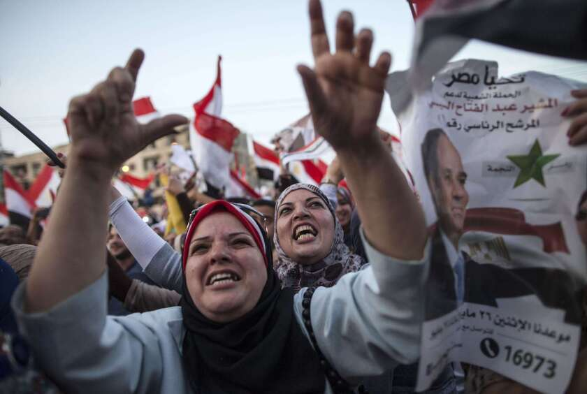 Egyptians celebrate in front of the presidential palace in Cairo on June 3 after ex-army chief Abdel Fattah Sisi won 96.9% of the vote.