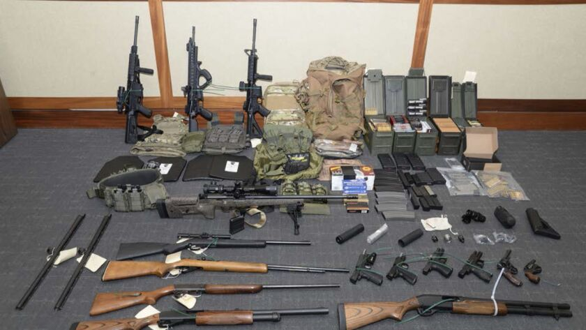 A display of firearms and ammunition that was seized from Coast Guard Lt. Christopher Paul Hasson, who prosecutors say is a white nationalist who was plotting terrorism.